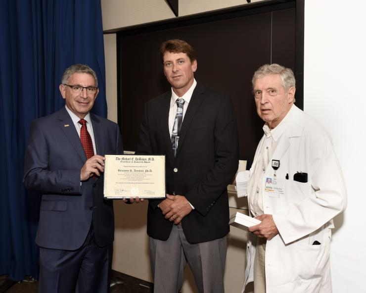 Dr. Benjamin Arenkiel with Drs. Paul Klotman and George Noon
